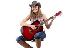 Portrait of woman playing guitar Royalty Free Stock Photos