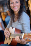Portrait woman playing guitar Royalty Free Stock Photography