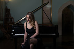 Portrait of Woman Playing Piano Royalty Free Stock Photos