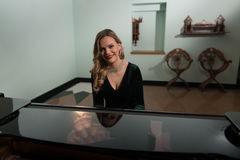 Portrait of Woman Playing Piano Stock Photography
