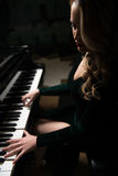 Portrait of Woman Playing Piano Royalty Free Stock Photo