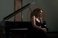 Portrait of Woman Playing Piano Stock Image