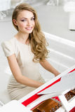 Portrait of woman playing piano Royalty Free Stock Image