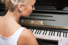 Portrait of woman playing on the retro style piano Stock Images