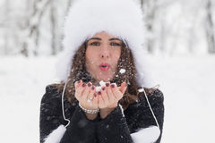 Portrait of a woman playing with snow. Winter portrait of a young woman playing with snow Royalty Free Stock Photo