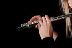 Portrait of a woman playing transverse flute Stock Image