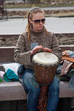 Portrait of woman plays the djembe drum in Volgograd Stock Photo