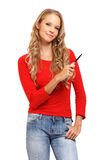 Portrait of a woman pointing with pen at copyspace Royalty Free Stock Images