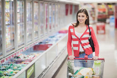 Portrait of woman posing with chart. At supermarket Royalty Free Stock Images