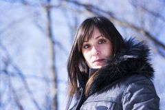 Portrait of a woman posing in the snow. Portrait of a pretty woman posing in the woods in winter Stock Image