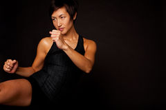 Portrait of woman practicing self defense. royalty free stock photography