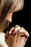Portrait of a woman praying with clenched hands. Royalty Free Stock Photos