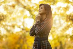 Portrait of a woman praying in nature, the girl thanks God with her hands folded at her chin, a conversation with the Creato. Portrait of a young woman praying royalty free stock photo