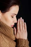 Portrait of a woman praying to God Stock Photos