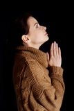 Portrait of a woman praying to God Stock Photography