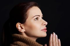 Portrait of a woman praying to God Stock Images