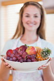 Portrait of a woman presenting a fruit basket Stock Photos