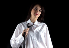 Portrait of woman pulling tie Stock Photos