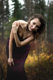 Portrait of woman in purple dress under rain Stock Photography