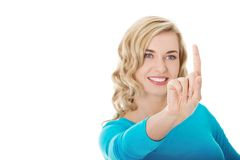 Portrait of woman pushing imaginary button Stock Image
