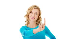 Portrait of woman pushing imaginary button Stock Photos