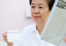 Portrait of a woman reading. In home Royalty Free Stock Photo