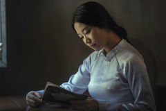 Portrait of woman reading book Stock Photography
