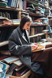 Portrait of a woman reading book in an old library Royalty Free Stock Images