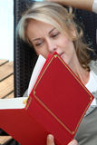 Portrait of woman reading book Stock Image