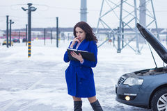Portrait of woman reading a manual car. Portrait of attractive woman reading a manual car Stock Photo