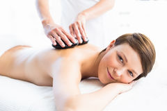 Portrait of woman receiving hot stone massage Stock Photo