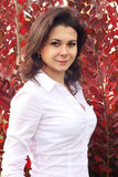 Portrait of Woman on Red Autumn Background Stock Photos