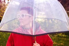 Portrait of woman with red coat under umbrella Royalty Free Stock Image