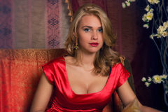 Portrait of woman in red dress Stock Images