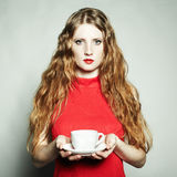 Portrait woman in a red dress with a cup of coffee Royalty Free Stock Photos