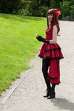 Portrait of woman with red dress sexy steampunk costume  at cosplay exhibition event stock photos
