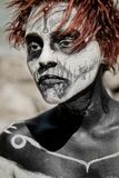 Portrait of woman with red hair and make up Halloween style Royalty Free Stock Images