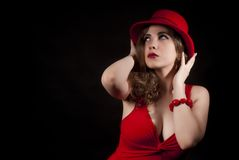 Portrait of woman with a red hat Stock Photos
