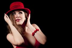 Portrait of woman with a red hat. Nice and elegant young woman with a red hat, smiling Stock Images