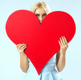 Portrait of the woman with a red heart Stock Images