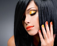 Portrait of a woman with red nails and glamour makeup Royalty Free Stock Image