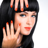 Portrait of a woman with red nails and glamour makeup Royalty Free Stock Photography