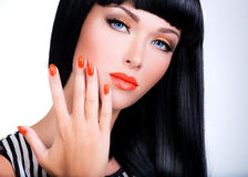 Portrait of a woman with red nails and glamour makeup Stock Images