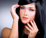 Portrait of a woman with red nails and glamour makeup Stock Photography