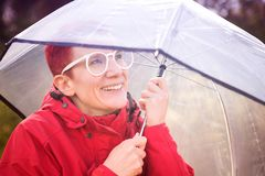 Portrait of woman in red raincoat and umbrella. Portrait of smiling woman in red raincoat and umbrella Stock Photos