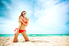 Portrait of woman in red swim posing on tropical beach. Young pretty hot sexy woman on the tropic island in summer near the sea. Young caucasian woman near ocean Stock Images