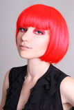 Portrait of woman in red wig Royalty Free Stock Photography