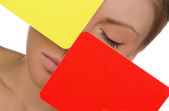Portrait of woman with red and yellow card. Isolated on white Stock Photos