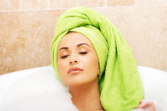 Portrait woman relaxing in bath with eyes closed Royalty Free Stock Photography