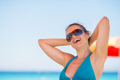 Portrait of woman relaxing on beach Stock Photo